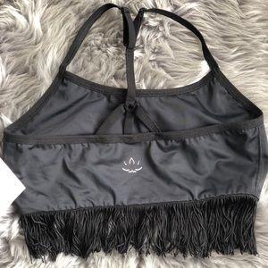 Beyond Yoga cross back sports bra with tassels